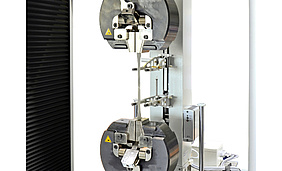 Grips and fixtures for universal testing machines